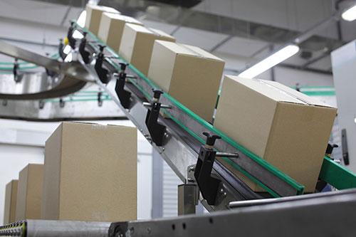 Packages on conveyor belt, ready for shipping